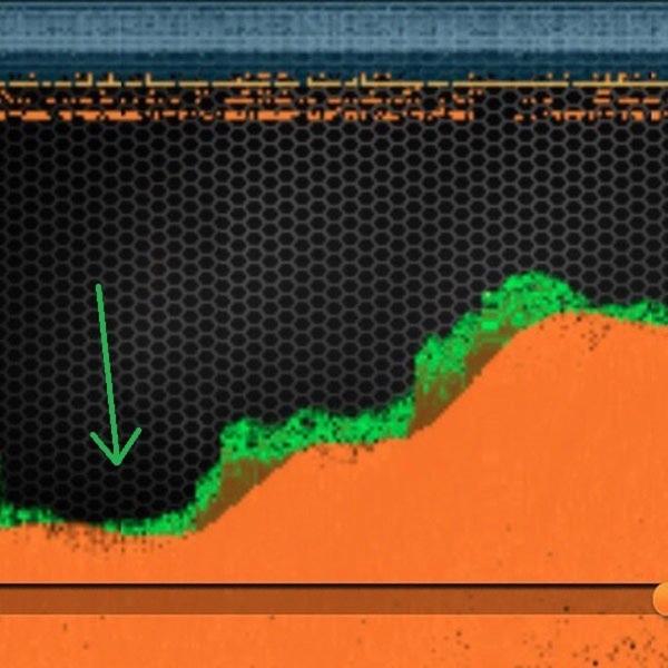 Klasyczna-karpiowa-górka-strzałka-wskazuje-idealne-miejsce-do-położenia-zestawu